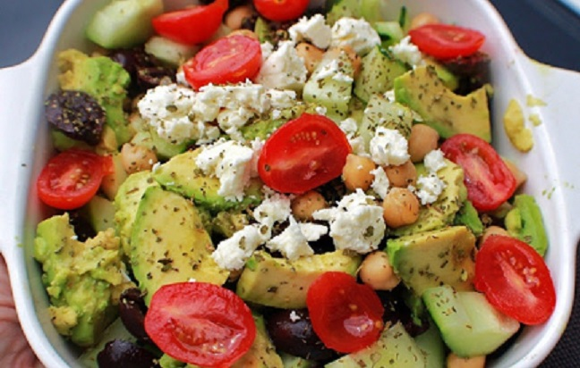 chopped fresh vegetables made into a Greek salad with feta cheese