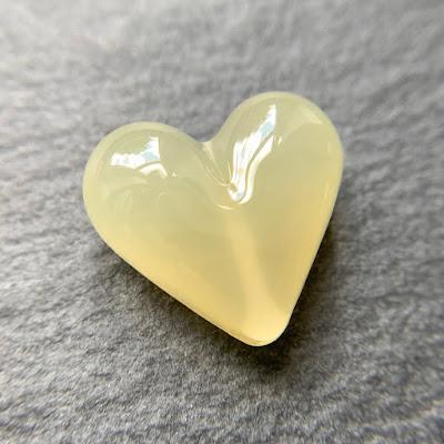 Handmade lampwork glass heart bead by Laura Sparling made with CiM Lemongrass