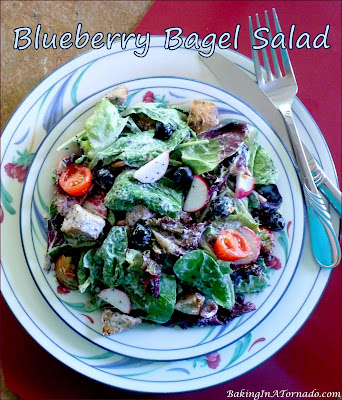 Blueberry Bagel Salad: mixed Greens, blueberries, and blueberry bagel croutons, topped with chicken and drizzled with creamy blueberry Greek yogurt dressing.   Recipe developed by www.BakingInATornado.com   #recipe #salad