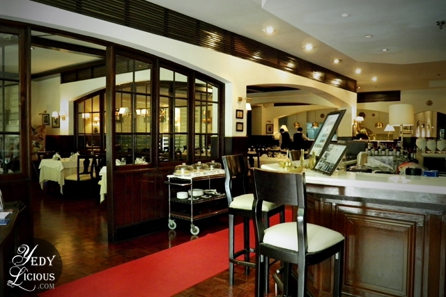 By The Entrance of Caruso Italian Restaurant in Makati