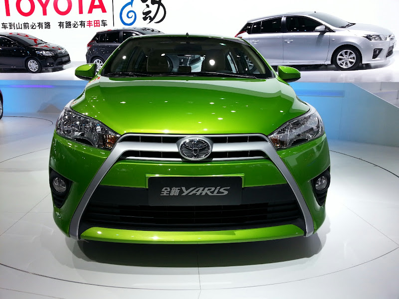 new yaris 2014 front view new yaris 2014 side view title=