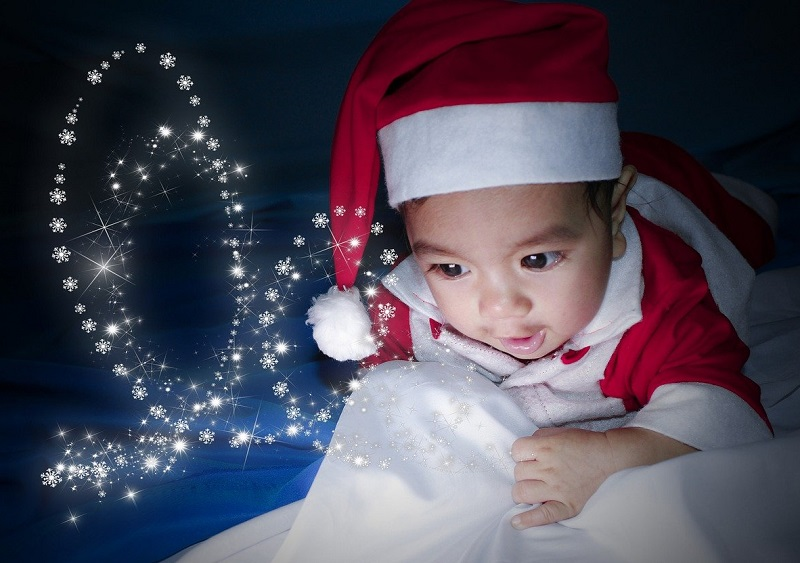 baby looking at christmas lights