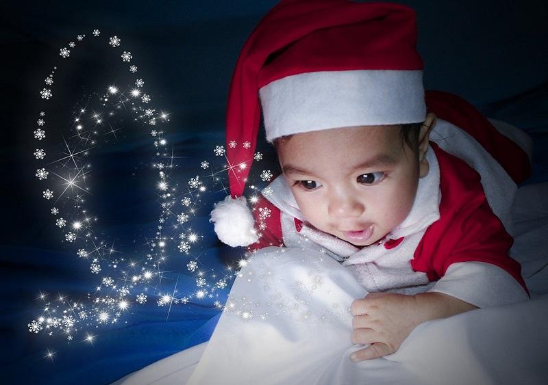 baby looking at christmas lights