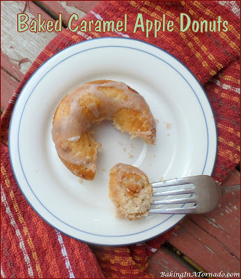 Baked Caramel Apple Donuts, bursting with apple, caramel and cinnamon Mix, bake, cool, and glaze, it's that easy. | Recipe developed by www.BakingInATornado.com | #bake #donuts