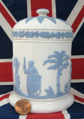 https://timewasantiques.net/collections/wedgwood/products/wedgwood-queens-ware-box-cylinder-lidded-classical-figures-1960s-blue-on-white