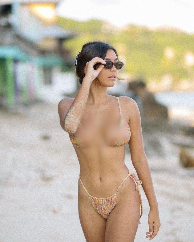 Foto Caitlin North Lewis Lawan Main Nicholas Saputra di 'PARANOIA', Gadis Muda Bali dengan Body Goals
