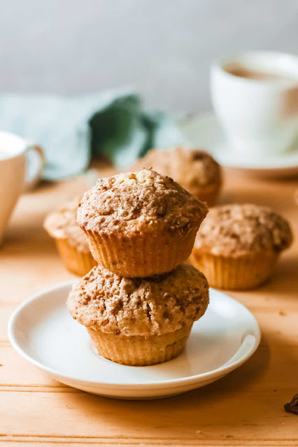stack of streusel covered pumpkin muffins