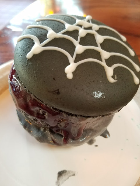 spider silk macaron ice cream sandwich with charcoal ice cream