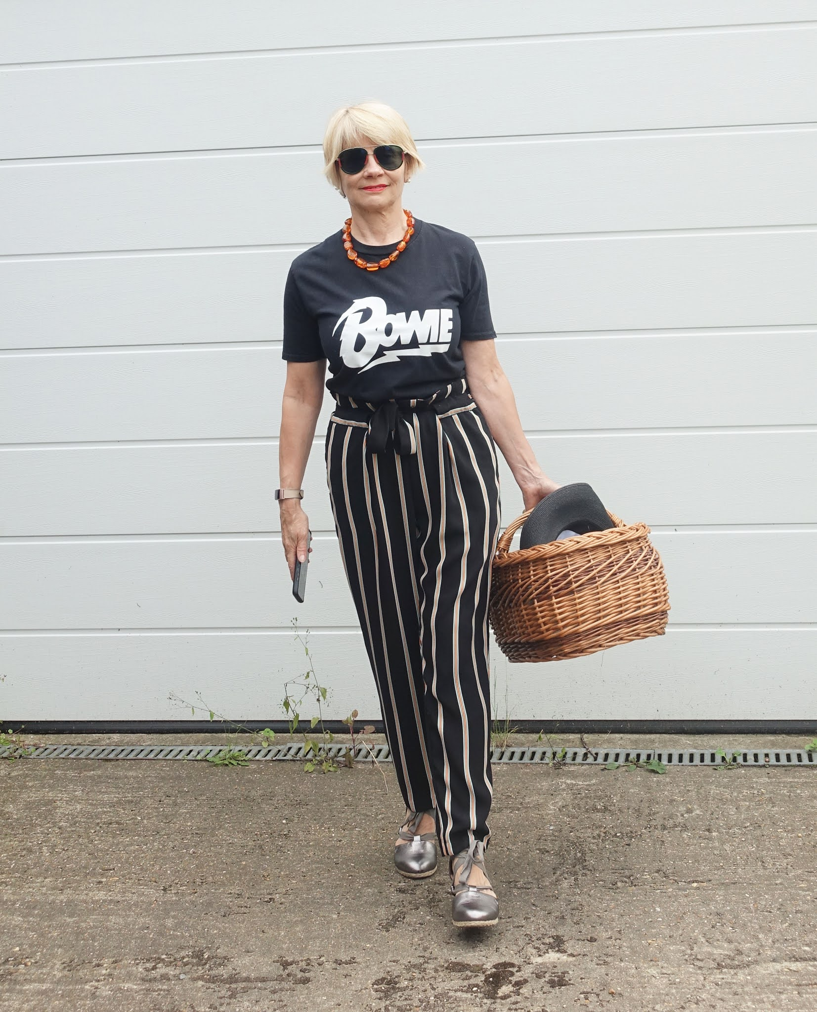 Is This Mutton blogger Gail Hanlon in casual attire for a picnic:  Bowie t-shirt, striped paperbag trousers, gunmetal wedges and Gucci sunglasses