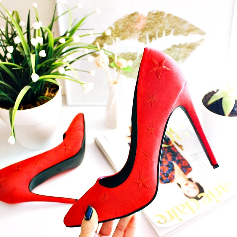 beautiful high heeled red pumps with star embroidery