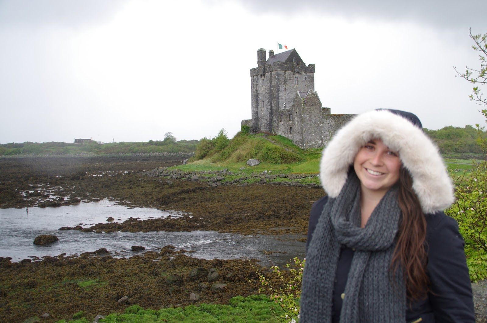 Girl posing in front of Dunguaire Castle