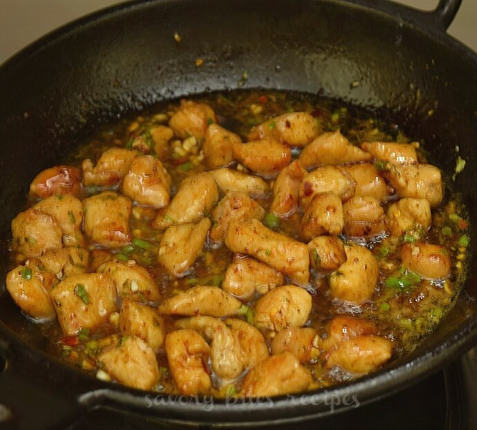 a black pan with chicken and add honey butter sauce