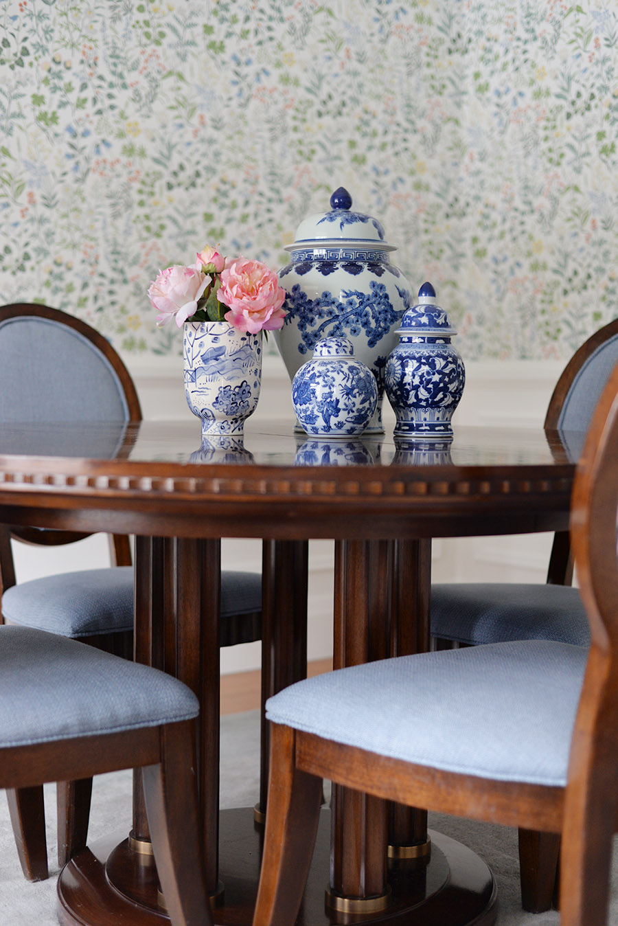 traditional dining room, oval back chairs, blue and white ginger jar collection, Scandinavian floral wallpaper