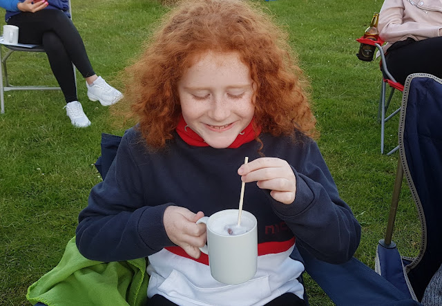 My 10 year old son drinking Ordsall Hall posh hot chocolate and grinning