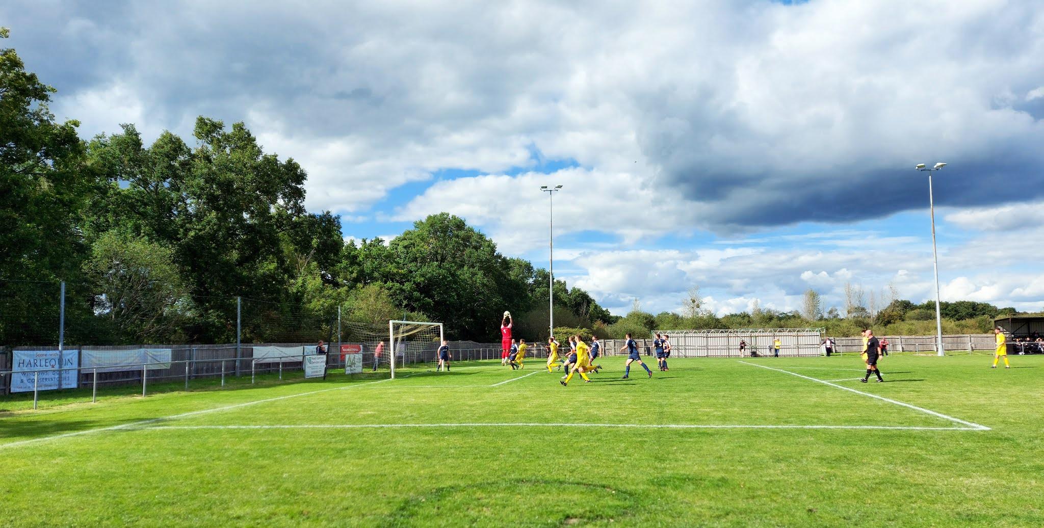 Hamble Club FC's goalkeeper, Ellis Grant, catches a Tadley Calleva cross