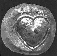 Moneda de cirene con forma de corazón.