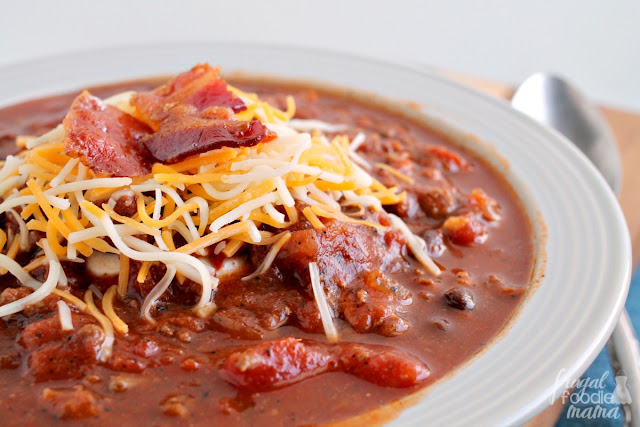 This hearty & comforting homemade chili recipe has two unexpected ingredients in it- ground venison & smoky, thick cut bacon.
