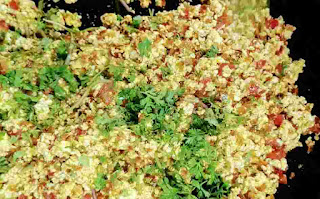 Chopped coriander leaves over paneer bhurji
