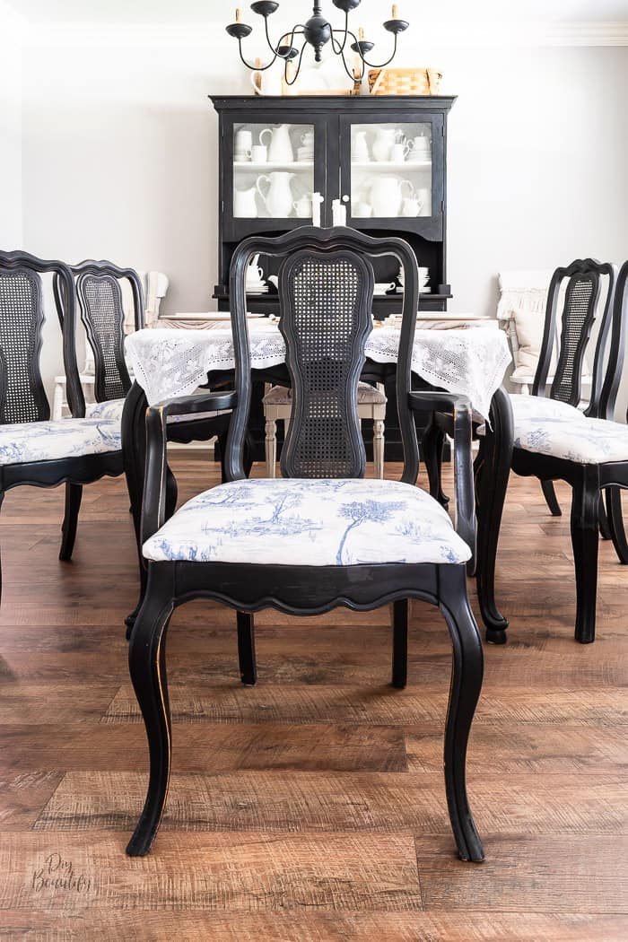 black vintage dining room furniture with blue toile seat cushions