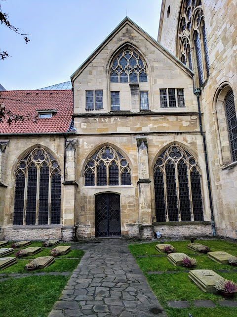 Courtyard garden and cemetery at St.-Paulus-Dom church in Muenster Germany