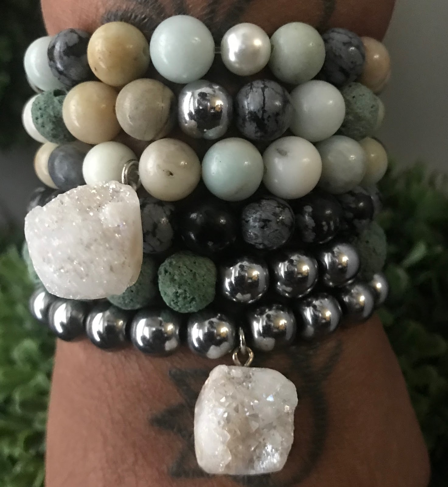 Tangie Bell is sharing the finished look by wearing DIY bracelets