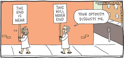 """Comic strip: Man walking while holding sign that says """"The End is Near"""" turns head to see man walking while holding sign that says """"This Will Never End,"""" tells first man, """"Your optimism disgusts me."""""""