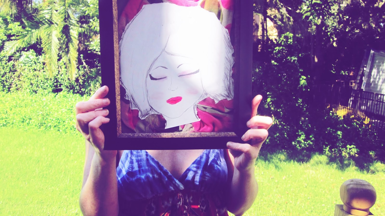A woman in a Kimono holding a mixed media art self-portrait in her hands as her face