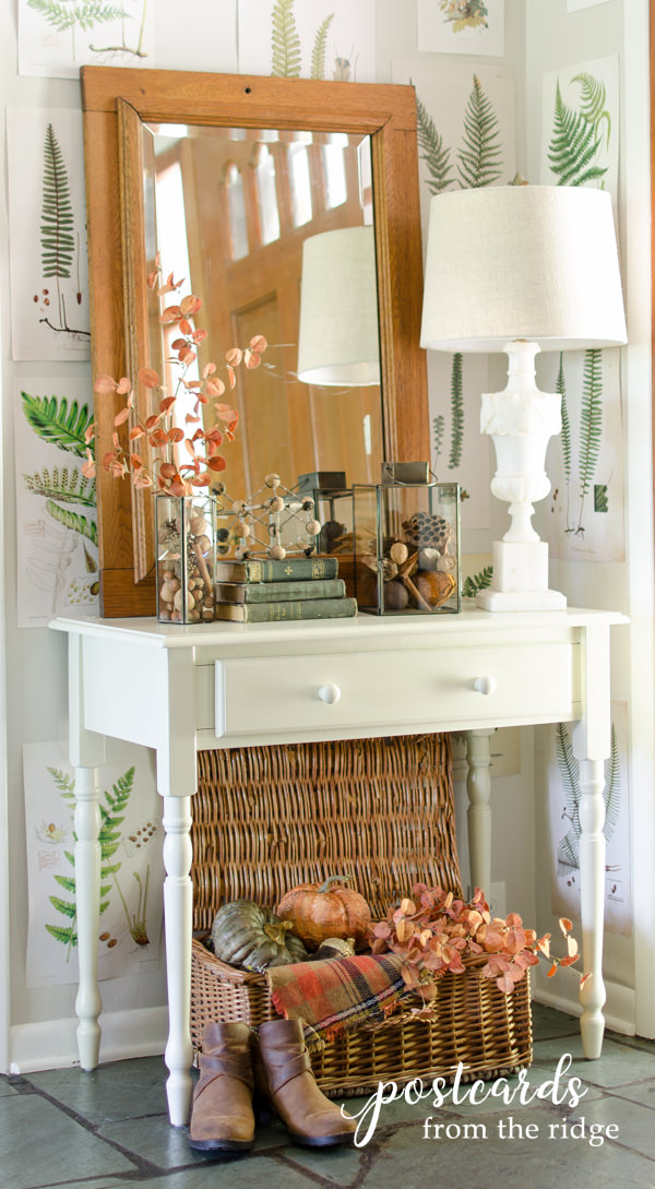 white entry table with fall decor