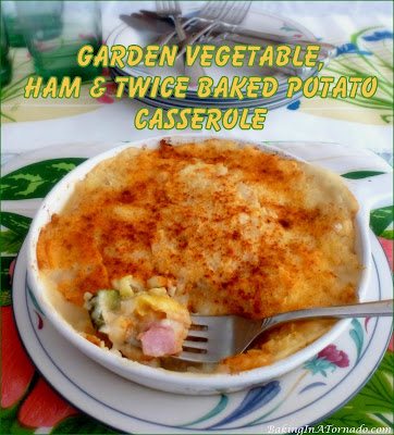 Garden Vegetable, Ham and Twice Baked Potato Casserole starts with sautéed vegetables, layered with cooked ham and topped with mashed potatoes. | Recipe developed by www.BakingInATornado.com | #recipe #dinner