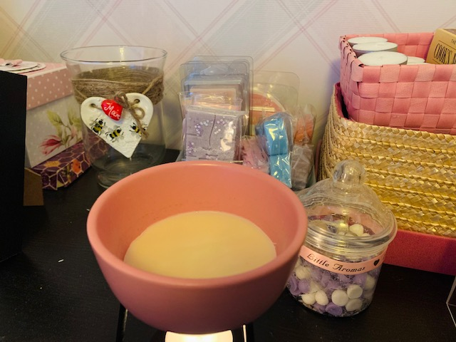 Wax burner in the bedroom, surrounded by melts