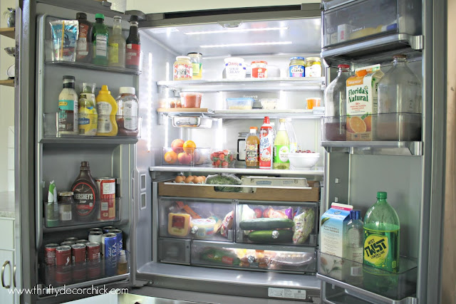 Kitchenaid refrigerator with wood accents and gray interior