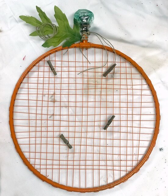 Repurposed Badminton Racket Pumpkin Photo Display