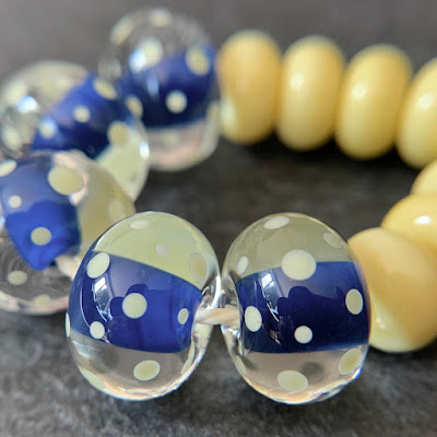 Handmade lampwork glass beads by Laura Sparling made with CiM Montezuma and CiM Ra