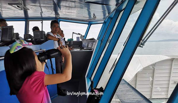 FastCat Ferry Bacolod-Iloilo - family trip - family travel - RORO- girls - Philippines - daughters - travelers - homeschooling - homeschooling in Bacolod- educational trip on board - business class - Captain Roseller Labanes - wayfarer binoculars - seafarer life