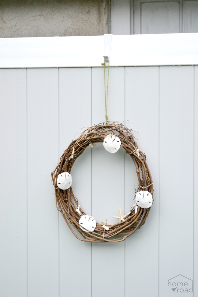 An over the door wreath hanger holding a wreath