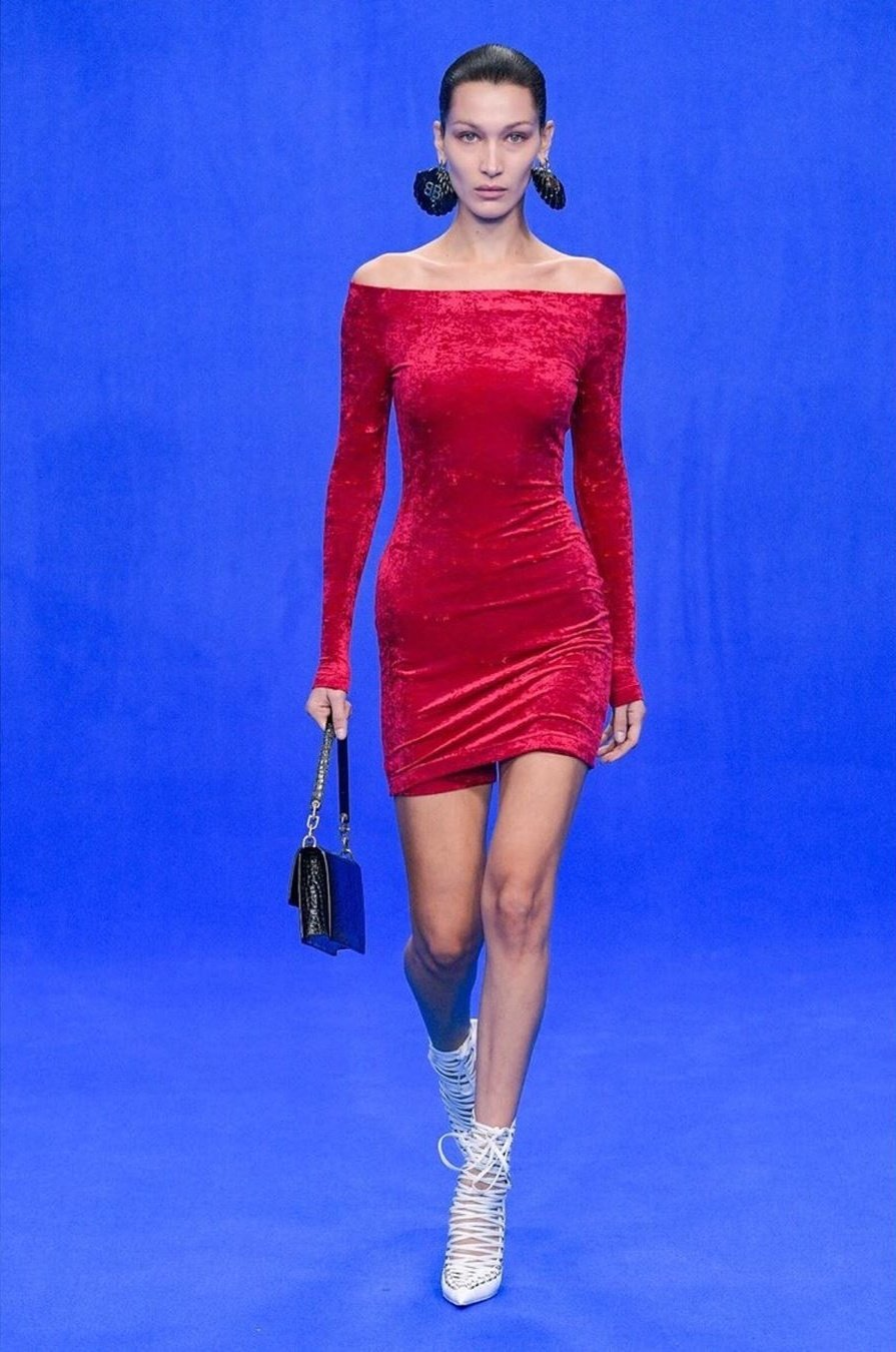 Bella Hadid slips into a velvet off-shoulder mini-dress as she unveils her freshly-dyed raven locks on the catwalk at Balenciaga's PFW show