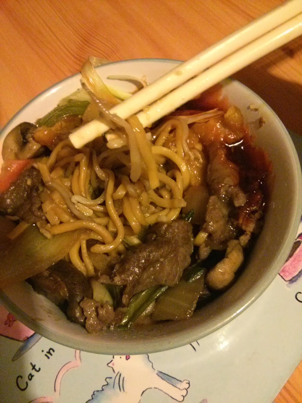 Bowl of Chinese Food with Chopsticks