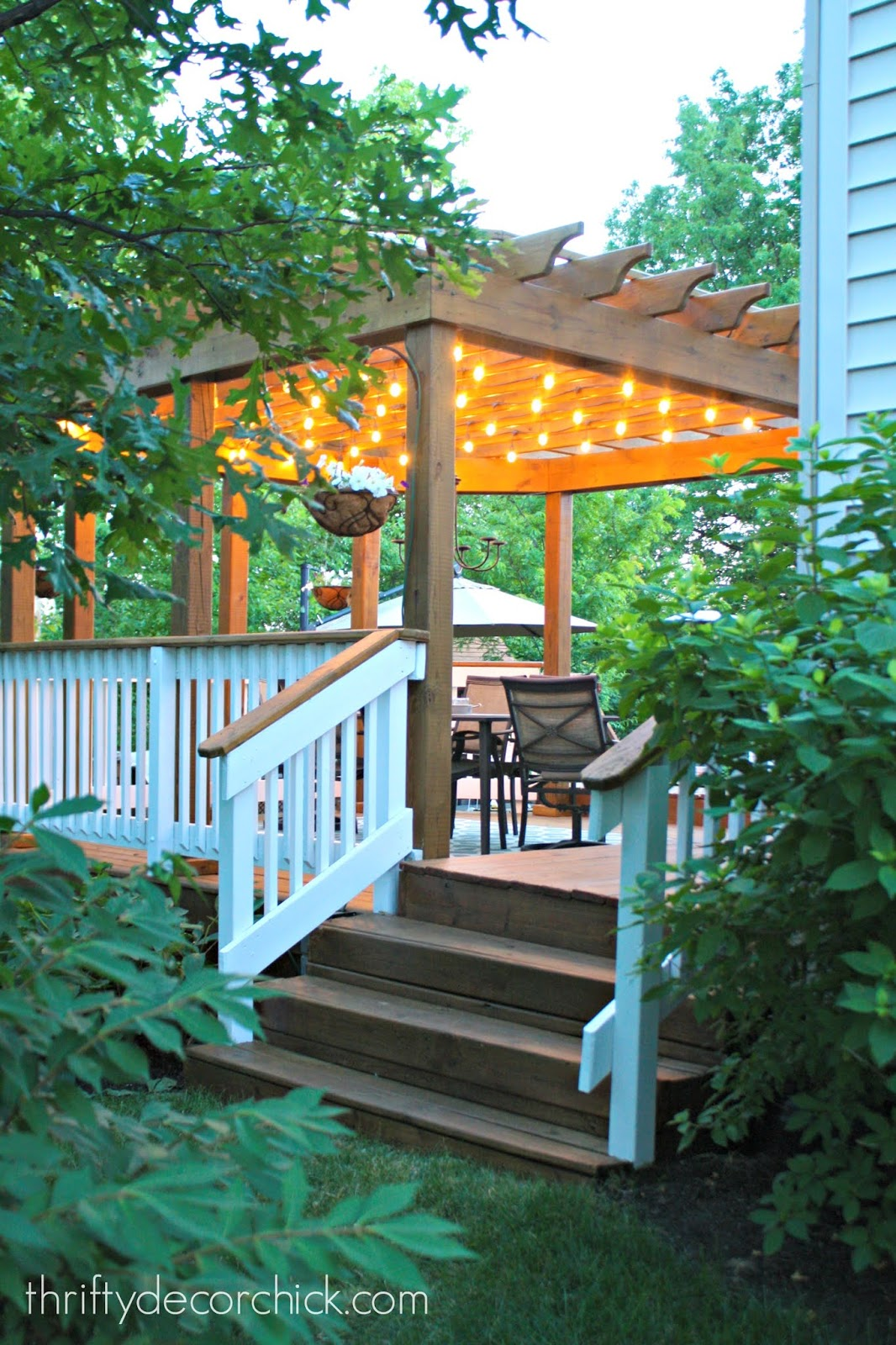 Hanging string lights under pergola