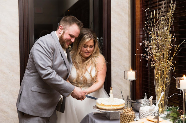 bride and groom cutting the cake at italian american cultural center in Clinton Township