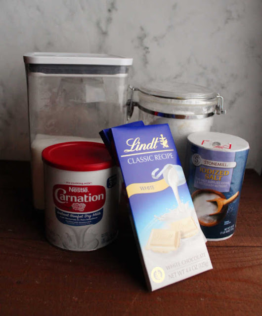 collection of 5 ingredients needed to make white hot chocolate