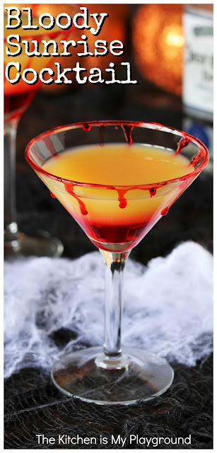 Bloody Sunrise Halloween Cocktail ~ Turn Tequila Sunrise's signature layers into a festive Halloween treat with this Bloody Sunrise cocktail! Add easy blood drips to martini glass rims, pour in classic Sunrise ingredients, & you've got one fun and tasty cocktail for sipping on Halloween night. Not a fan of tequila? Mix up a sweeter Malibu Sunrise version instead. #Halloweencocktails #Halloweendrinks #tequilasunrise  www.thekitchenismyplayground.com