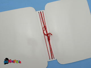 rilegatura con filo per il quaderno dei ricordi di natale - December Daily