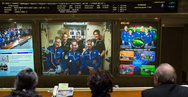 Expedition 49 Flight Engineers Andrey Borisenko of Roscosmos, front left, Sergey Ryzhikov of Roscosmos, front center, and Shane Kimbrough of NASA, front left, are seen with Flight Engineer Kate Rubins of NASA, back left, Commander Anatoly Ivanishin of Roscosmos, back center, and Flight Engineer Takuya Onishi of the Japan Aerospace Exploration Agency (JAXA), back right, as they talk with friends and family at the Moscow Mission Control Center in Korolev, Russia a few hours after the Soyuz MS-02 docked to the International Space Station on Friday, Oct. 21, 2016 in Korolov, Russia. Photo Credit: (NASA/Joel Kowsky)
