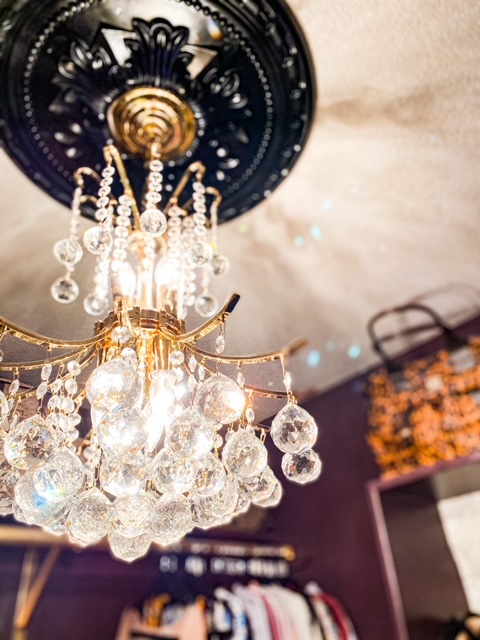 brass and crystal chandelier in closet