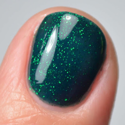emerald glitter nail polish close up