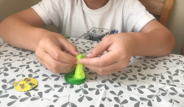 popping open pop pop snotz toy green slime and small toy