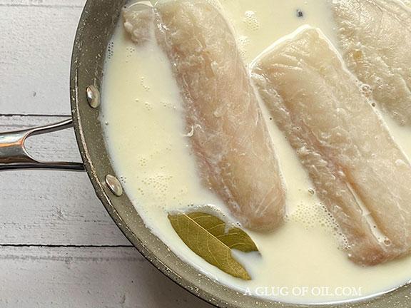 Poaching cod in milk