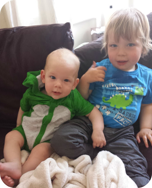 brothers, baby and toddler on sofa