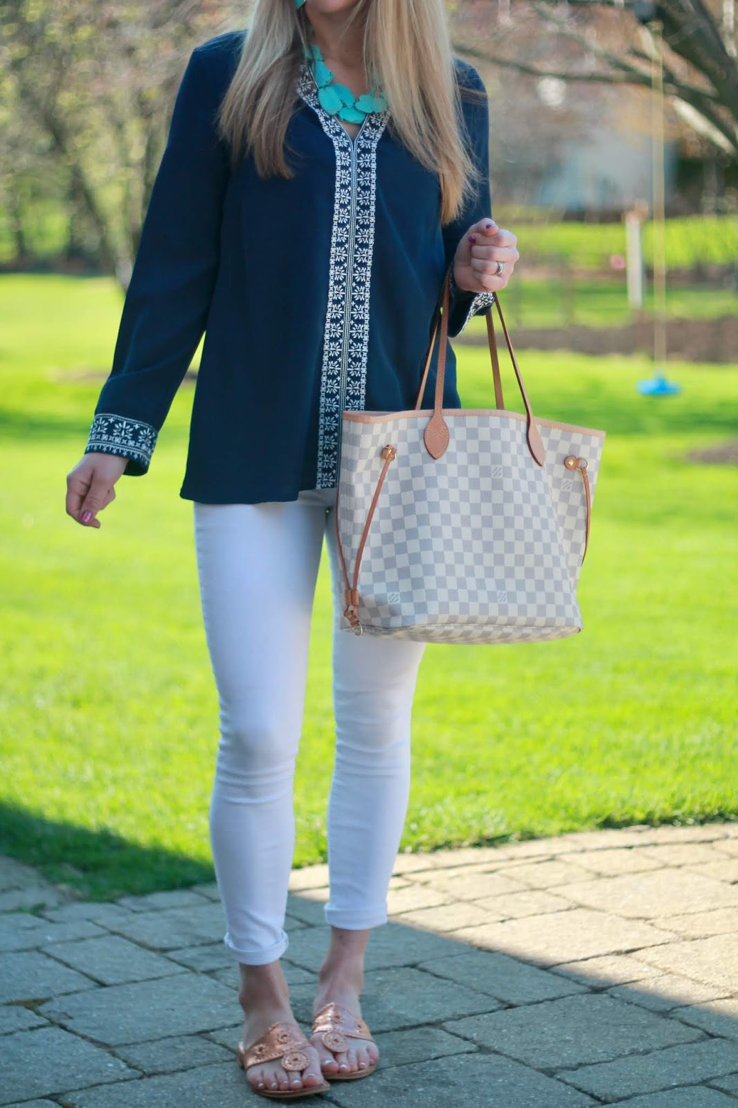 navy embroidered top, white jeans, turquoise necklace, LV azure Neverfull, jack rogers sandals, spring casual outfit white jeans