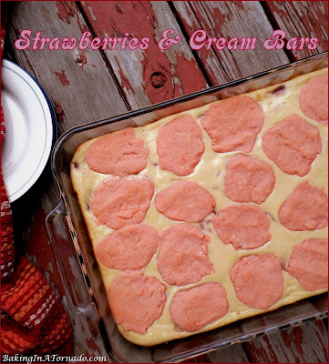 Strawberries and Cream Bars, a creamy cheesecake-like center studded with strawberries in a cookie dough crust and topping. | Recipe developed by www.BakingInATornado.com | #recipe #dessert